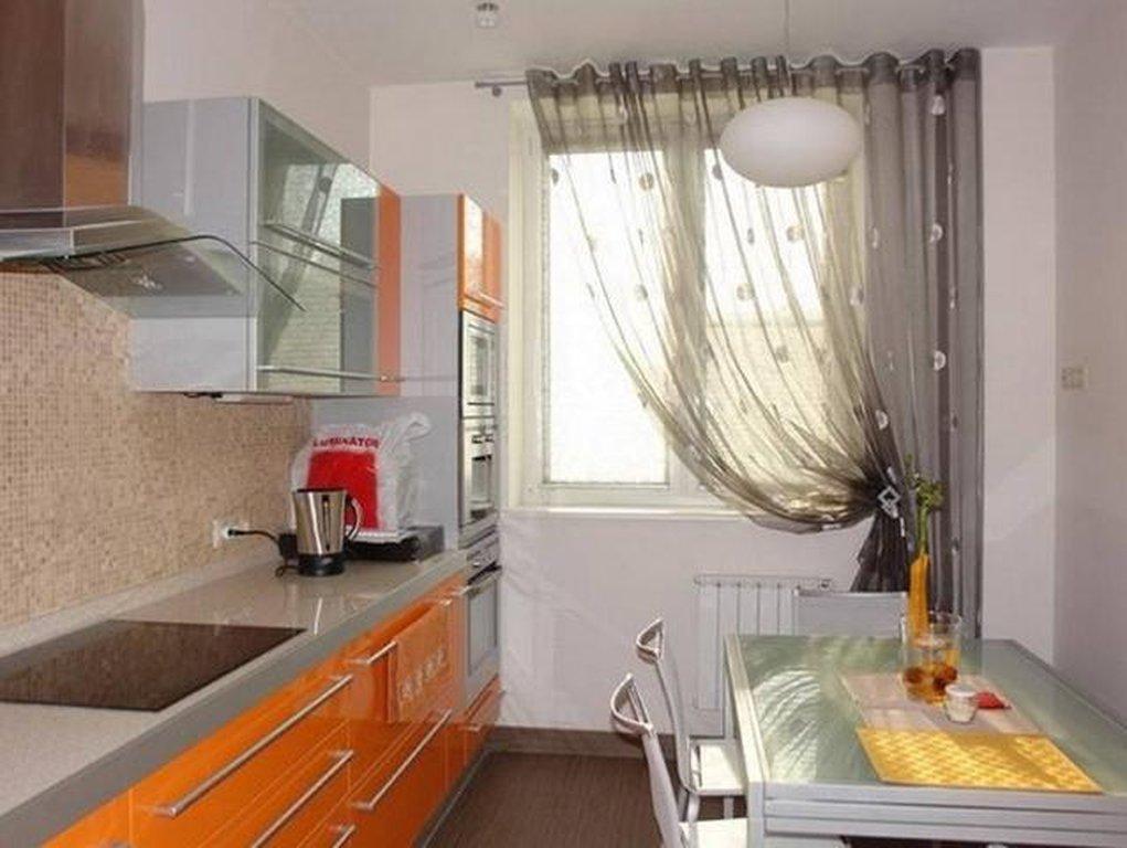 Дизайн кухонного окна занавески